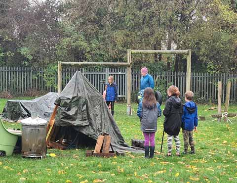 Forest schools den making fun at our holiday camp.